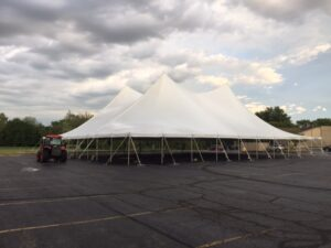 100' wide Pole Tent, capable of going as long as 100'x180'